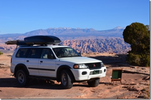 Mitzi near Island In The Sky, and Arches NP in the background